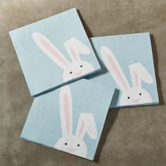 Shop Easter Bunny Paper Lunch Napkins Set of 20.  A playful, long-eared bunny takes a peek on our pastel blue paper lunch napkins.  Measuring six inches square, our napkins are printed and manufactured in the U. S.