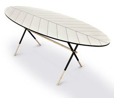 Piuma Table, Pietro Russo, 2013. Oval table with intarsia in curly maple and pattern of a bird feather, tubular iron legs painted in black with ends and crosspieces in solid maple. Legs joints and feet elements in brushed brass.