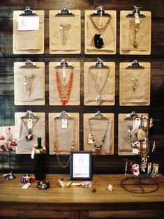 Clipboards - simple to hang & easy to change for jewelry displays. The clipboards can be covered w/ cloth (loose burlap) or contact paper, wrapping paper or scrapbook pages. Use one or two to hold signs, pricing or product information. The display as shown costs less than $20. Clear colored acrylic or pre-printed clipboards are available at a bit more cost. Other ideas of product to display: note cards, cloth napkins, scarves