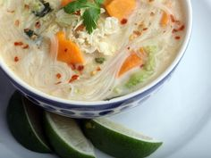 Lemon coconut cabbage soup 3 oz rice-stick noodles 1 TBS oil 1 tsp fresh ginger 2 stalks lemongrass cut into 2-inch lengths 1 pound sweet potatoes, peeled and cut into 1/2-inch dice 5 tablespoons reduced-sodium soy sauce 1/4 teaspoon crushed red pepper 1 small head Napa cabbage, sliced crosswise 1/3 inch thick (about 5 packed cups) 1 cup unsweetened coconut milk Juice of 1 lime, plus lime wedges for serving 2 1/2 cups cilantro