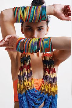 Use twine-like yarn, and knot in friendship bracelet styles.  Possibly secure to cardboard (?) hoops cut from poster tubes?