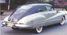 1947 Buick Roadmaster fastback 2-door coupe, fender skirts, the famous bomb site ornament. Straight-8. Fast. And shiny.