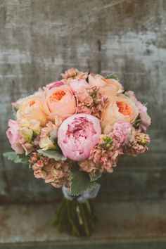 Pink peony and peach garden rose bouquet // photo by http://www.cptphotography.com, via http://theeverylastdetail.com/yellow-peach-minnesota-farm-wedding