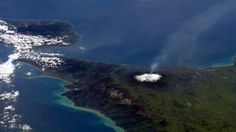 Astronaut Chris Hadfield took this shot of a trail of smoke drifting from Sicily's Mt Etna volcano from the International Space Station (ISS).