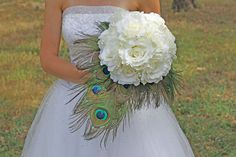 Peacock Wedding Bouquet - White Roses and Peacock Feather Bridal Bouquet. $120.00, via Etsy.