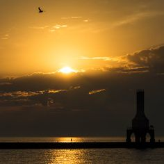 This golden August sunrise welcomed a new day. Taken in Port Washington Wisconsin from Coal Dock Park overlooking Lake Michigan. Port Washington Wisconsin, Lake Michigan, Lighthouses, All Over The World, Sunrise, Park, Outdoor, Beautiful, Outdoors