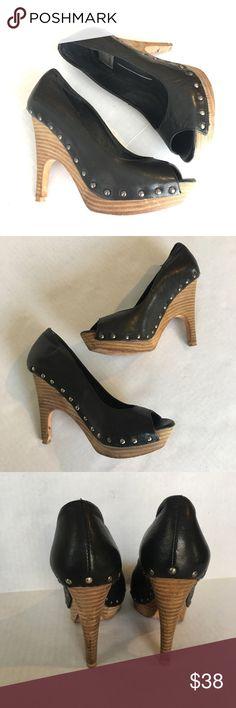 Dolce vita black peep toe heels Dolce vita black peep toe heels. Upper leather and wood heels with stud trim detail. Dolce Vita Shoes Heels