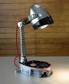 I made this table lamp from old motor parts (engine block, shock absorber). Some parts have been polished, and after the red-black decoration the whole lamp has been lacquered. The head of the lamp can be adjusted to up and down and every directions as well. The red cable is approx. 1,5 m long. The LED bulb has G10 socket. The height of the lamp is approx. 45 cm. Additional informations: - The lamp was made in Europe, but you can use it in the USA / UK with an AC transformer or w...