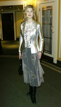 Pin for Later: From Bond Girl to Gone Girl: Rosamund Pike's Red Carpet Evolution Rosamund Pike Something tells us this shiny jacket and sheer skirt from 2003 is a look Rosamund is happy to leave in the past.