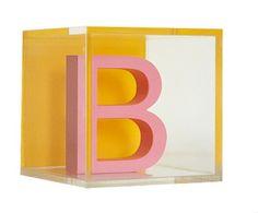 Custom Modern Letter Blocks: Pink Letter/Tangerine Orange Background. $18.95, via Etsy.