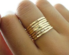 This Hammered & Polished Gold-filled stacking ring set is entirely hand-made & mixes well with most of the items in our store.  • This listing is for one 7-band set. You will receive:  • Four 16g Hammered Gold-filled rings  • Three 16g Polished Gold-filled rings  • When stacked, they measure at about 7 rings per half inch.  • We do make 1/2 & 1/4 sizes, just leave a note with your size preference.  • All of our items are entirely hand crafted and have a standard processing time of 3-5…