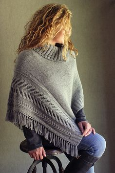Autumn is a second spring, when every leaf is a flower. Welcome fall with this stylish poncho, knit in mainly stockinette stitch with a dramatic cabled border, knit-in fringe and a cozy collar that can button up as a cowl.