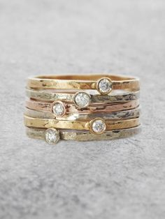 A single sparkling Diamond lights up these beautiful, organically textured stacking rings. Perfect for layering, or stunning solo as a delicate flash of Sparkle and Light. Band measures appprox. 1.5mm