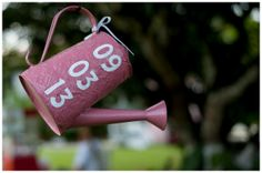 decoration for wedding field - watering can with wedding date