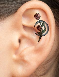 two-carnation-flowers-and-a-moon-tattoo-for-the-ear.jpg 501×649 pixels