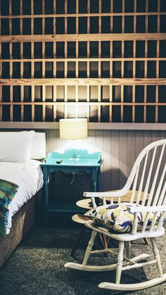 This Modern Irish hotel is set next to the Atlantic Ocean, the interior design combines modern with rustic traditional decor ideas.  While the architecture of the reception is rustic with details found in a country cottage or farmhouse. The natural seaside setting inspires the bedrooms and suites colors.   | #desk | #bed| #rockingchair  |