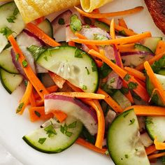 Carrot salads are refreshing, and this one--with cucumbers, red onion and a zesty cilantro-chili vinaigrette--is sure to become a new favorite. It's excellent served with grilled fish. Celery Recipes, Carrot Salad Recipes, Cabbage Salad Recipes, Salad Recipes Video, Veggie Recipes, Healthy Recipes, Healthy Dinners, Healthy Foods, Healthy Life