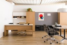 In this space, Canvas Private Office is enhanced by elegant details like our new, universal plywood edge on the work surface. A nearby Eames Table, surrounded by Eames Soft Pad Chairs, provides a comfortable yet elegant place for people to gather.