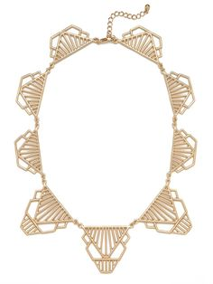 The Jazz Age meets Cleopatra cool in this stunning statement collar, which flaunts a graphic cage silhouette that speaks to both sensibilities. We love it.