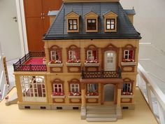 I found this vintage Playmobil mansion for my daughter. Gorgeous! I may just display it in the family room once she outgrows it.