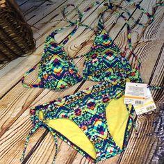 PRETTY SNAKE PRINT STRING BIKINI Pretty and colorful string bikini in a snake print pattern. Top is padded NWT.  JUNIOR SIZING Beach Stop Swim Bikinis