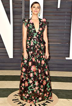 Rashida Jones brought spring to the carpet in a floral-print Andrew Gn dress, green Lorraine Schwartz jewelry, Stuart Weitzman heels, and a Salvatore Ferragamo bag.