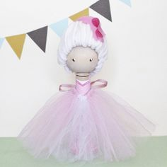 """Let them eat cake!""  Our one-of-a-kind Marie Antoinette clothespin doll stands approximately 5.5"" tall and is hand painted and sealed with a non toxic gloss finish. Her hair is made of white yarn, adorned with hand cut petals. Her dress/skirt is made from pink and white tulle and secured to he..."