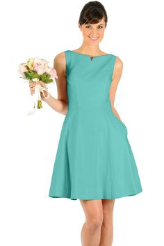 The Audrey is a bridesmaid dress with clean lines, a classic silhouette, and unexpected details.  The dress features a high neck accentuated with cut-out notch detailing, A-line skirt, deep V-back, and pockets.