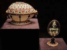 1894. Imperial Fabergé Egg No. 10, the Renaissance Egg. Emperor Alexander III to Empress Maria Feodorovna.  Here it is displayed with the Resurrection Egg, which some believe to be its surprise.  The Resurrection Egg is made of gold, rock crystal, diamonds, pearls and enamel.  It bears the mark of Mikhail Perkhin.  Both eggs are now in the Viktor Vekselberg collection in Russia.