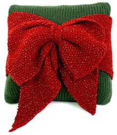 Don't make Santa  bring this present down the chimney--make it yourself with this free knitting pattern! This Christmas Present Pillow would be cute on the sofa or to fill in the spaces under the tree.