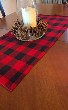This beautiful table runner is made of buffalo plaid red and black cotton flannel with black top stitching. This cozy flannel runner adds just the right rustic look for your winter table, lumberjack themed birthday party or baby shower. Perfect for everyday use or for special occasions.