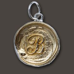 My next addition from Waxing Poetic  http://www.waxingpoetic.com/antique-brass-insignia-charms-4