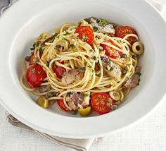 This pasta supper, packed with canned fish, olives, tomatoes, capers and parsley, is a quick and colourful dish for one