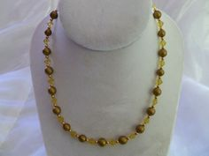 Great gift, buy it now!    This 17 inch necklace was made using matte yellow diamond and gold round Czech glass, with 14K Gold Filled beads and a lobster claw clasp.    This one of a kind necklace would be great with my vintage glass pearl and Vermeil bracelet and my vintage glass pearl and 14K Gold Filled earrings. All three would be great for a day at the office or a night on the town.    This item is ready for immediate shipment, so you will receive this exact item. | Shop this product…