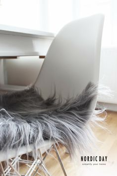 White Eames DSR chair and Bloomingville Grey Icelandic sheepskin cushion  / Nordic Day