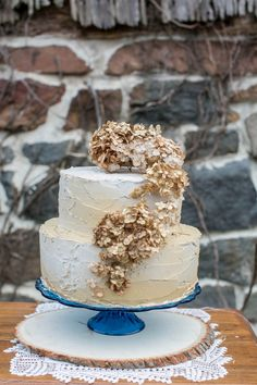 dried hydrangea cake topper, photo by Tom and Keidi Photography http://ruffledblog.com/leafy-winter-inspiration #weddingcakes #rusticwedding