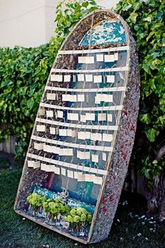 It's smooth sailing for guests at this nautical themed wedding. Individual escort cards line the bars of this rowboat for effortless organization.