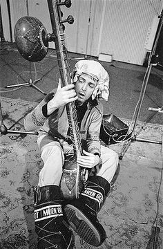 """""""I was in the studio recording a little overdub on something. But I've no idea why I have a tea towel or a hanky on my head Nothern seaside style, and am playing sitar, because I don't play sitar."""" #mccartney #stoned #moonboots"""