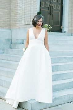 Modern Carolina Herrera wedding dress: http://www.stylemepretty.com/new-jersey-weddings/jersey-city/2017/03/31/waterfront-restaurant-wedding/ Photography: Christina Lilly - http://www.christinalilly.com/