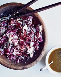Soaking radicchio in ice water removes its bitterness, making this balsamic-dressed salad with Manchego cheese extra-delicious.