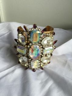 This large statement rhinestone cuff bracelet is one of a kind.  It was made from a brooch with vintage chec republic.  It has to be 4 by 4. No one will ever own it and the cuff bracelet in brass is adjustable and will fit many wrist sizes. What a wonderful gift it jewelry for that special occasion  - $99.99
