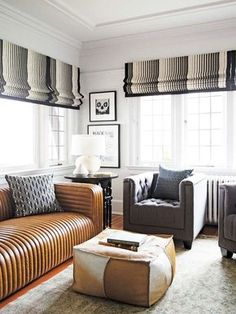 Living room with leather channel tufted sofa