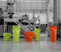 Green and orange 'crumpled' containers