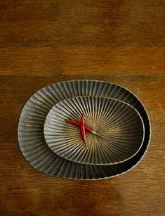 Oval platters by Japanese ceramic artist Yasushi Kuno
