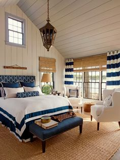 Feel the breeze from the water, breath in the salt air, and take in this beautiful blue and white bedroom featuring #RalphLauren fabrics. The fabric Lighthouse Stripe in White/Navy is used to create the Grommet Draperies accented with antique brass grommets. All window treatments are entirely custom made to our customer's specifications. Visit our website to see more new fabrics from Ralph Lauren and to learn more about custom window treatments! Fabrics at Calico! Image: calicocorners.com