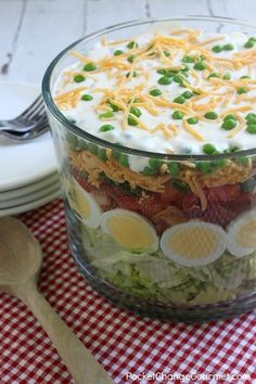 Heading to a potluck? Hosting a cookout? This Seven Layer Salad Recipe is a MUST make! A crowd-pleaser for sure! It's super easy to make, can be made ahead and feeds a crowd!