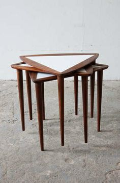 Arthur Umanoff; Walnut and Formica Stacking Tables, 1950s.