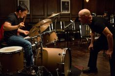 whiplash 2014  - Andrew Neyman (Miles Teller), a young jazz drummer who attends one of the best music schools in the country under the tutelage of the school's fearsome maestro of jazz named Terence Fletcher (J.K. Simmons), struggles to make it as a top jazz drummer.
