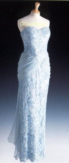 Designed by Catherine Walker, Diana wore this pale blue lace and beaded gown several times. Lot #18, Diana first wore this dress in February 1987 in Portugal for a banquet following their 4 day tour. She also wore it in November 1987 on a visit to Qatar. It then had a high neck and long sleeves. She wore it in 1987 for dinner in Munich. In March 1989 she wore it in London. by then it was altered to strapless with a short train. In 1990 it was also worn in Nigeria. The dress raised $ 36,800.