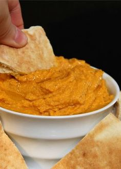 This may be the most perfect Halloween Appetizer ever! I love hummus, I love pumpkin things...so why not combine them into a delicious Pumpkin Hummus?